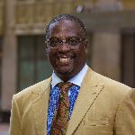 Dr. Carlton Sharp